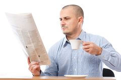 Casual businessman with newspaper Royalty Free Stock Image