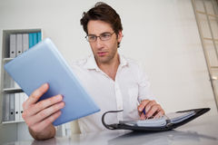 Casual businessman organizing his schedule at his desk Royalty Free Stock Photos