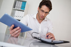 Casual businessman organizing his schedule at his desk Stock Image