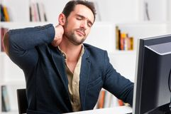 Casual Businessman With Pain In His Neck Stock Image
