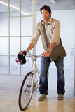 Casual businessman pushing his bike Stock Photos