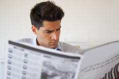 Casual businessman reading the newspaper Stock Images
