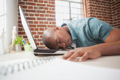 Casual businessman sleeping at his desk Royalty Free Stock Image