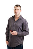 Casual businessman with smart phone Royalty Free Stock Images