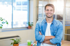 Casual businessman smiling at camera with arms crossed Stock Photos