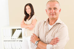 Casual businessman smiling crossed arms Stock Photos