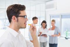 Casual businessman smoking an electronic cigarette Stock Photo