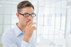 Casual businessman smoking an electronic cigarette Stock Photos
