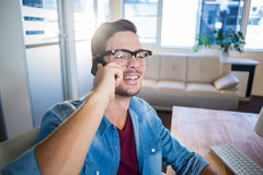 Casual businessman speaking at the phone Stock Images