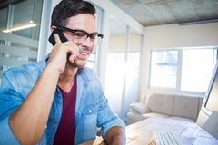 Casual businessman speaking at the phone Stock Photography