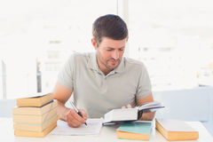 Casual businessman studying at his desk Stock Photography