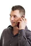 Casual businessman talking on smart phone Stock Image