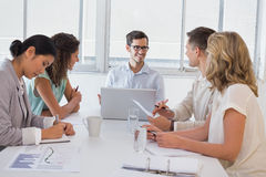 Casual businessman talking to team during meeting Stock Images