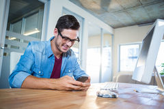 Casual businessman texting with his mobile phone Royalty Free Stock Photo