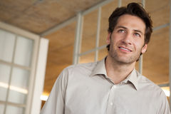 Casual businessman thinking and smiling Royalty Free Stock Photography