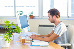 Casual businessman typing on keyboard Stock Photos