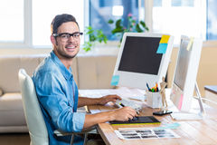 Casual businessman using digitizer at his desk Stock Image