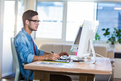 Casual businessman using digitizer at his desk Royalty Free Stock Photo