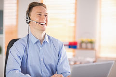 Casual businessman using headset on a call Royalty Free Stock Photos