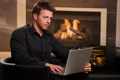 Casual businessman using laptop at home Royalty Free Stock Photo