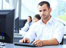 Casual businessman using laptop in office Royalty Free Stock Photos