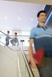 Casual Businessman Walking Down Stairs Royalty Free Stock Photos