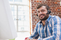 Casual businessman wearing a headset Stock Photos