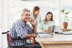 Casual businessman in wheelchair phoning Stock Photography