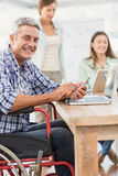 Casual businessman in wheelchair with smartphone Royalty Free Stock Photo