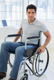 Casual businessman in wheelchair smiling at camera Royalty Free Stock Image