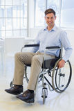 Casual businessman in wheelchair smiling at camera Stock Image