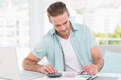 Casual businessman working with calculator Royalty Free Stock Photo