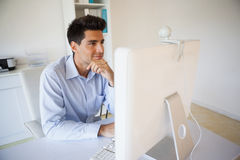 Casual businessman working at his desk Stock Images