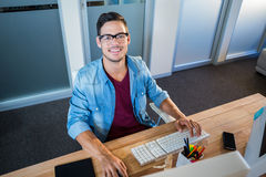 Casual businessman working at his desk Royalty Free Stock Images