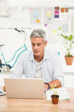 Casual businessman working with laptop Stock Images