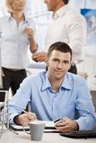 Casual businessman working in office Stock Images