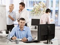 Casual businessman working in office Royalty Free Stock Image