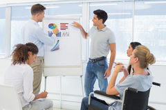 Casual businessmen giving presentation to colleagues Royalty Free Stock Photo