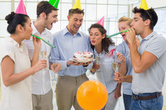 Casual businessmen team celebrating a birthday Royalty Free Stock Images