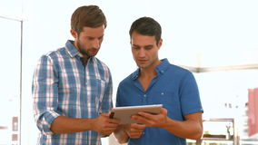 Casual businessmen using tablet computer stock footage