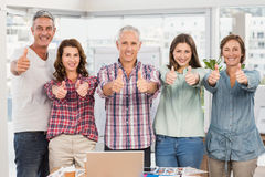 Casual businesspeople thumbs up in line Stock Image
