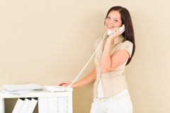 Casual businesswoman attractive smiling on phone Royalty Free Stock Images