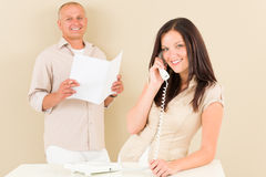 Casual businesswoman calling phone man colleague Stock Images