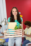 Casual businesswoman carrying her belongings in box Stock Photography