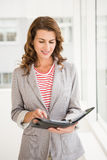 Casual businesswoman checking her planner Royalty Free Stock Photos