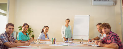 Casual businesswoman giving presentation to her colleagues Royalty Free Stock Images
