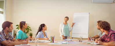 Casual businesswoman giving presentation to her colleagues Stock Image