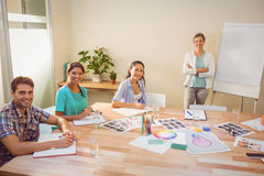 Casual businesswoman giving presentation to her colleagues Stock Photos