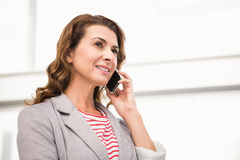 Casual businesswoman having a phone call Stock Photography