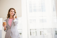 Casual businesswoman having a phone call Royalty Free Stock Photos